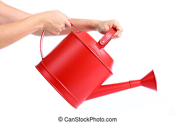 Women used hand holding Red Watering pot with white...