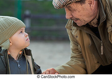 Grandpa and grandson - Grandfather and his 2 years old...