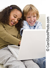 Children On The Internet - Two young children surfing the...