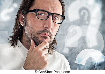 Businessman thinking and questioning. Portrait of thoughtful...