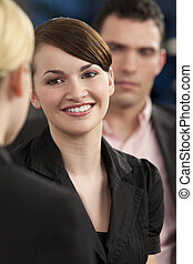 Business Meeting - A smiling businesswoman meeting and...