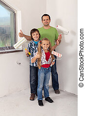 Kids with their father preparing to paint the room