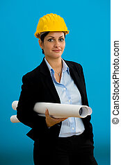 Young female architect in hardhat with blueprint isolated on...