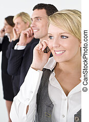 Business Communications - A businesswoman and a team of 2...