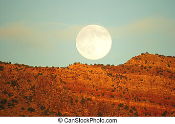 Prairie moon - A prairie landscape picture of the the full...