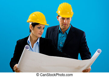 Architects looking blueprint