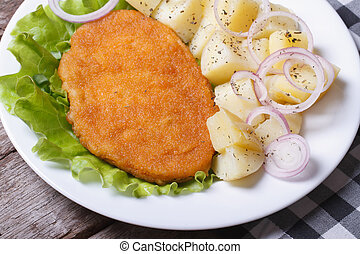 Schnitzel with young boiled potatoes top view - Schnitzel...