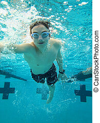 teen swimming freestyle stroke, view from underwater