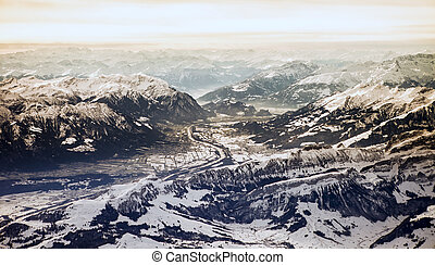 aerial of swiss alps in winter