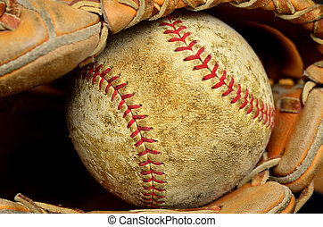 Baseball and Mitt or Glove - Worn old baseball in brown...