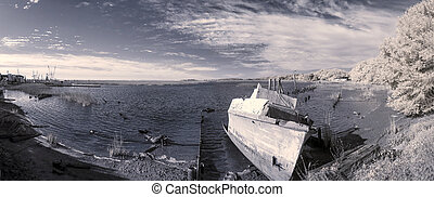 abandoned boat scene, infrared photo - infrared photo of...