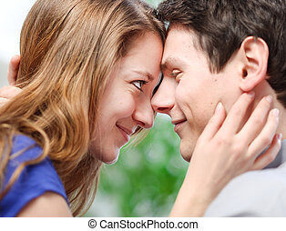 Attractive couple of lovers look at each other with love