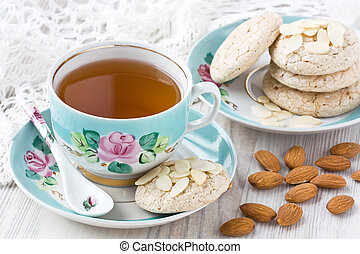 Cup tea with almond cookies - Porcelain cup of tea with...
