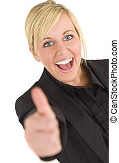 Thumbs Up - An attractive young blonde businesswoman gives a...