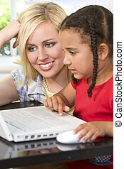 Family Learning - A beautiful young mother and her mixed...