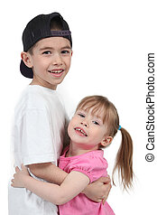 Adorable little brother and Sister on studio background -...
