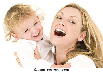 Mother And Child In White - A young blonde mother and her...