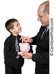 Man puting Money in Boys Piggy Bank - Business man Giving...