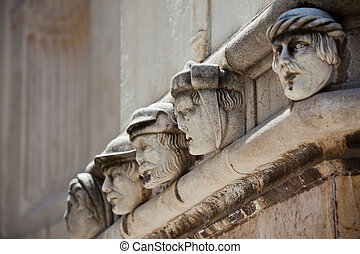 Stone heads at Cathedral of St. James in Sibenik, Croatia....