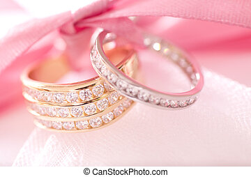 Gold and silver wedding rings on a cushion