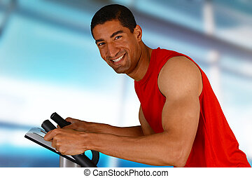 Man Working Out On Bike - Man working out while at the gym...