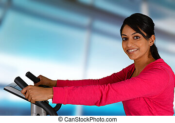 Woman Working Out On Bike - Woman working out while at the...