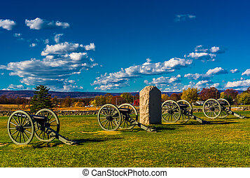 Cannons and a monument at Gettysburg, Pennsylvania. -...