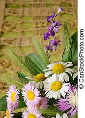 Wild flowers on craft background