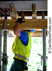 Construction worker - Worker at the construction site with a...