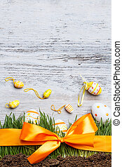 Easter background with eggs and grass