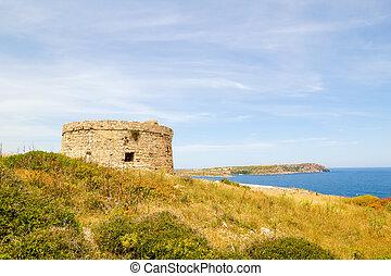 Torre d'en Penjat uncared fort scenery at Menorca, Spain