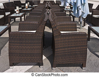 Outdoor cafe - Brown wicker chairs and tables of outdoor...