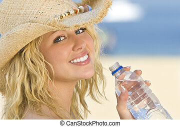 Woman Drinking Cool Water - A sexy and beautiful young blond...