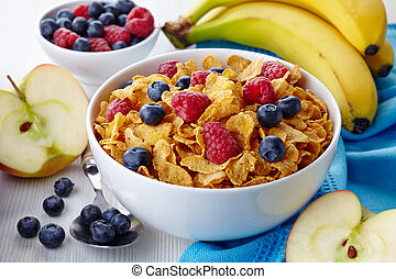 Corn flakes - Bowl of corn flakes and fresh berries and...