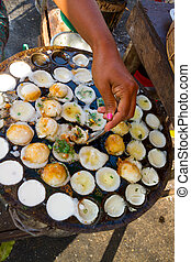 Myanmar street food - Delicious pancakes prepared and sold...