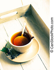 Cup of tea with lemon on the wooden table