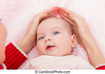 Adorable baby - Portrait of an adorable baby defended by her...