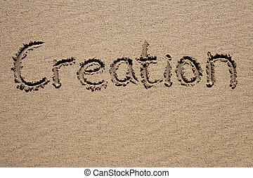 Creation, written on a sandy beach.