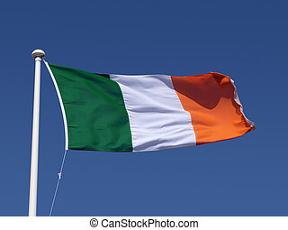 The Irish tricolour flag and blue sky.