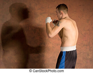 Young boxer in fitness training working out