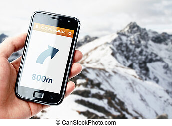 Hand holding smartphone with gps navigation