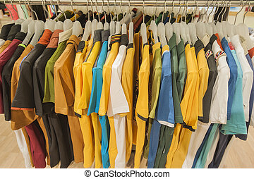 Row of tshirts hanging on a rail - Selection of fashion...