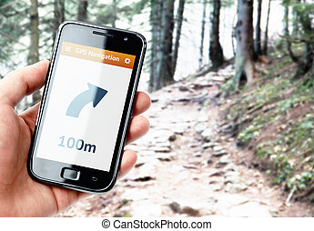 Hand holding smartphone with gps navigation on the screen
