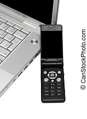 Mobile phone and computer - Mobile phone on the keyboard of...