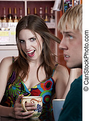 Woman flirting with male friend in a coffee house