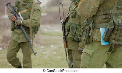 Soldiers on duty - Three armed soldiers on duty. Close-up