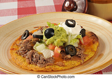 Shredded beef tostada - A tostada with shredded beef,...
