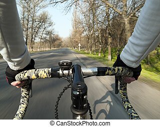 Bicycle ride - Bicycle steering close-up durng ride summer...