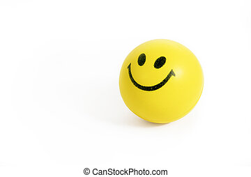 smiling face stress ball on white background