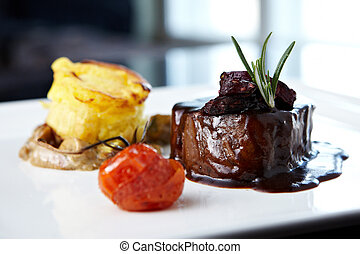 Roasted beef tenderloin with herb-potato muffin, mushroom...